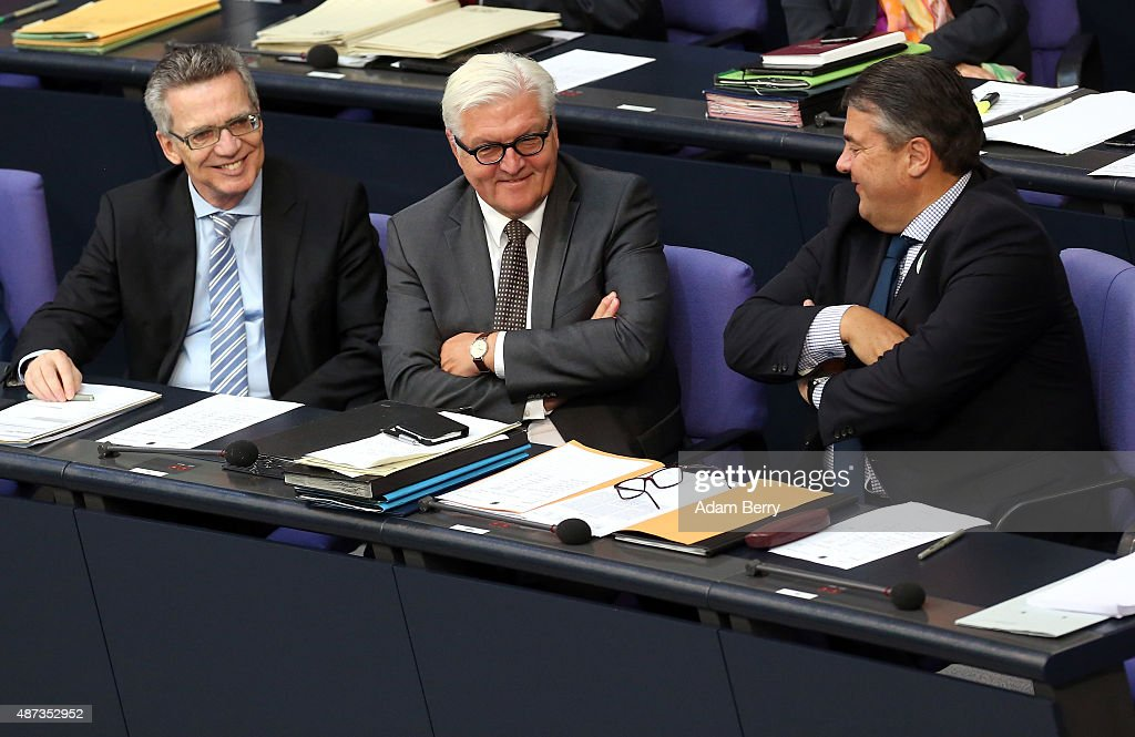 Interior Minister Thomas de Maiziere (CDU, L) and Vice Chancellor and Economy and Energy Minister Sigmar Gabriel (SPD, R) congratulate Foreign Minister Frank-Walter Steinmeier (SPD, C) on his part in Iran nuclear negotiations as German Chancellor Angela Merkel (CDU, unseen) speaks during a session of the Bundestag, the German parliament, on September 9, 2015 in Berlin, Germany. Merkel spoke primarily about the refugee crisis currently being faced by Europe, and has stressed that a European Commission (EC) plan to spread 160,000 migrants among European Union member countries may not be sufficient as the Continent may need to be prepared to receive an even higher number of asylum seekers in the current wave.