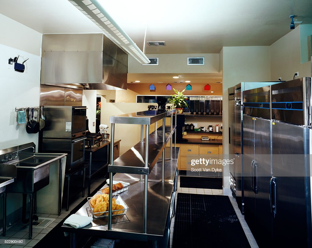 interior of a kitchen is seen having a metallic finish stock photo