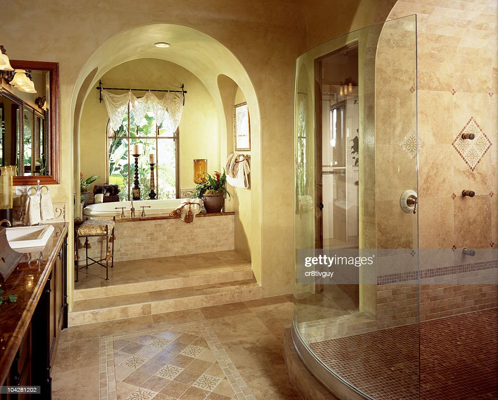 Interior Of A Luxury Bathroom With Stand Up Shower And Tub Stock ...