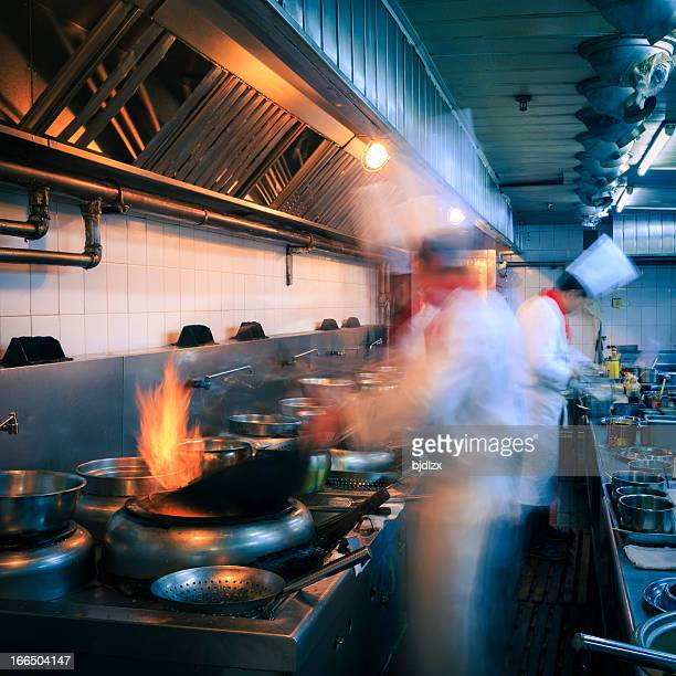 Interior of a restaurant kitchen with busy chefs