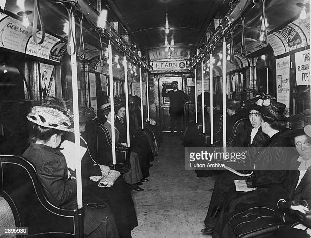 Interior of a subway car with female passengers and a uniformed male conductor