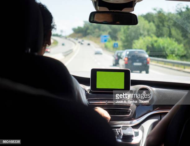 Interior of a vehicle circulating along a highway with the help of a GPS one day with traffic and the Sun. Catalonia, Spain