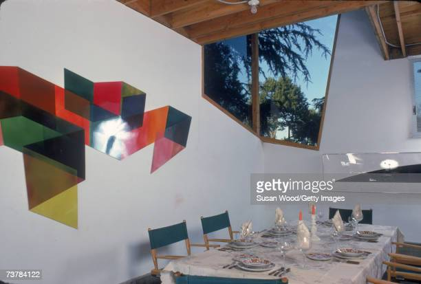 Interior of American modern architect Frank Gehry's house showing the dining area just off the kitchen Santa Monica California January 1980