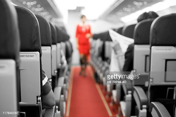 Interior of an airplane with cabin crew in the background