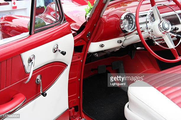 Interior of an old red and white classic automobile