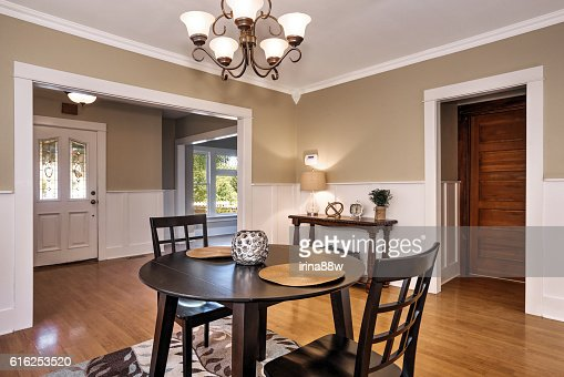 Interior of dining room  with black table and two chairs : Foto de stock