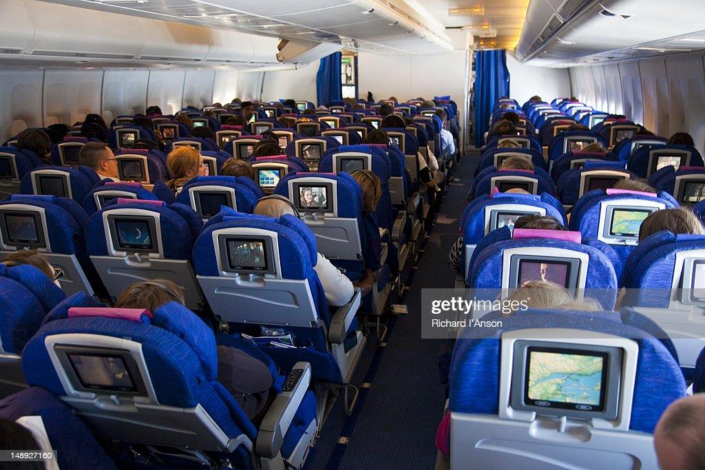 Interior of economy class cabin on international flight.