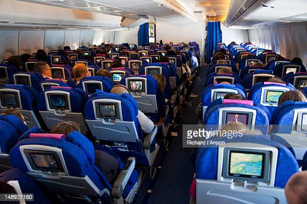Interior of economy class cabin on international flight.
