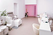 Interior of empty modern nail salon. Work places for masters of manicure