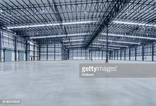 Interior of empty warehouse : Stock Photo