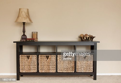 Interior of home credenza with blank wall space