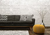 Modern interior of living room with black sofa, rug and knitted pouf over white brick wall 3d rendering