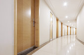 empty long modern corridor with many rooms