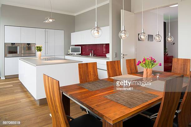 Interior of modern flat, Dining area and open plan kitchen