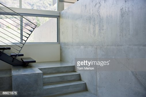 Interior of modern house, metal staircase : Stock Photo