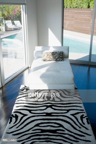 Interior of modern living room with glass walls : Stock Photo