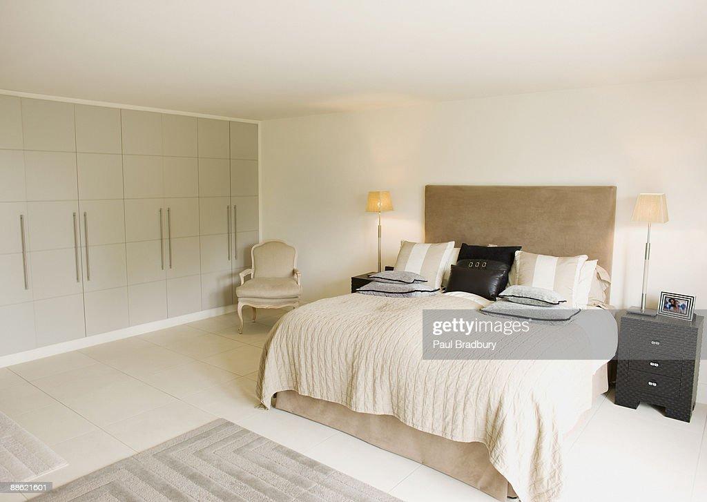 Interior of off-white modern bedroom