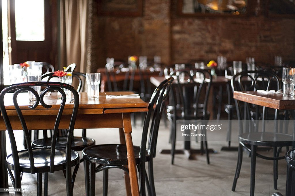 Interior of restaurant with table settings : Stock Photo