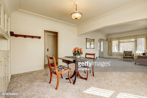 Interior of retro style dining room with carpet floor : Stock Photo