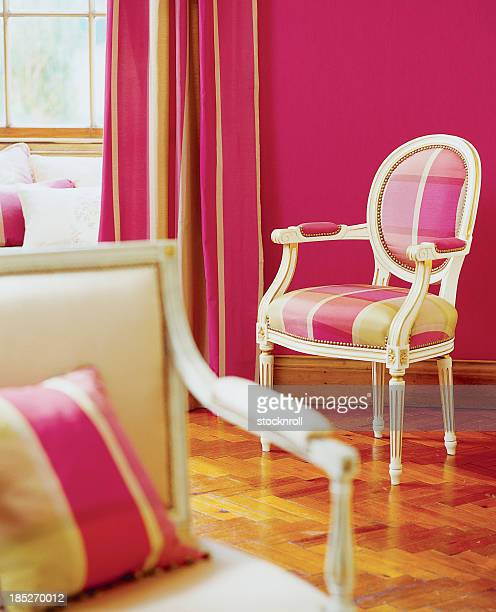 Interior of stylish chairs In Window