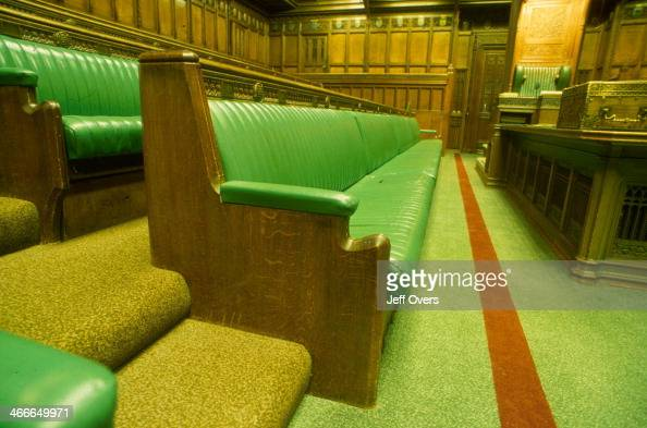 Interior of the chamber of the House of Commons in the Houses of Parliament / Palace of Westminster This detail shows the government front bench and...