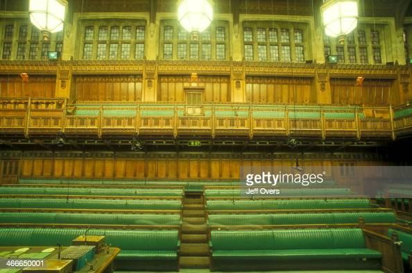Interior of the chamber of the House of Commons in the Houses of Parliament / Palace of Westminster This the Table of the House on the front left and...