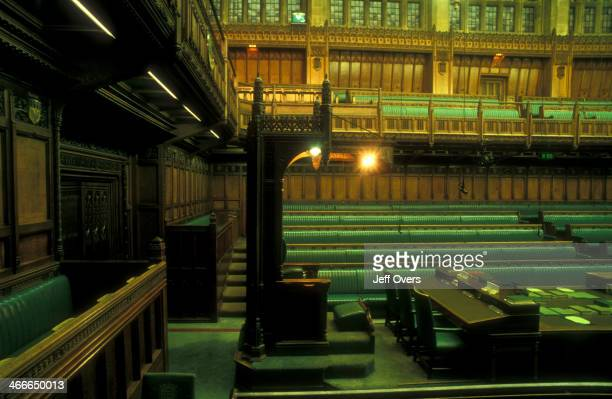 Interior of the chamber of the House of Commons in the Houses of Parliament / Palace of Westminster This the Speakers Chair with the seats of the...