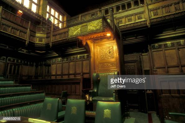 Interior of the chamber of the House of Commons in the Houses of Parliament / Palace of Westminster This the Speakers Chair with the Press Gallery...
