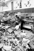 Interior of the Food City supermarket at Walton Ave and East Burnside Ave in the Bronx with spoiled food and looted discards as clerks restock the...