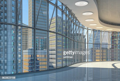 Interior of the hall with curved glazed walls and a view of the skyscrapers : Stock Photo
