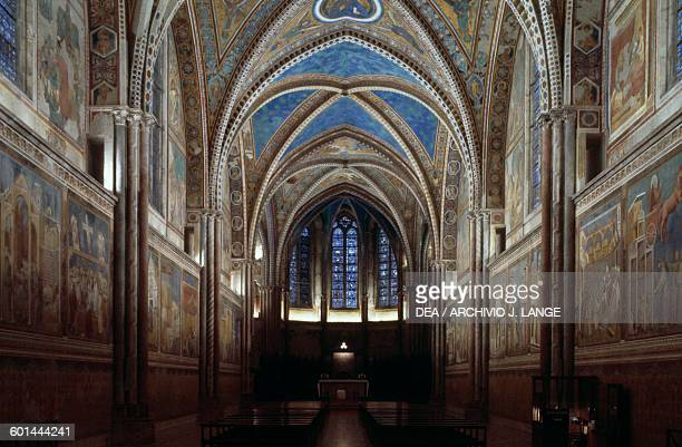 Interior of the Upper Basilica of St Francis and its frescocovered walls Assisi Umbria Italy