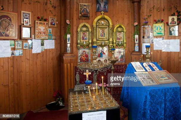 Interior of the wooden Russian Orthodox church in Pomor style at Barentsburg coal mining settlement at Isfjorden Spitsbergen / Svalbard Norway