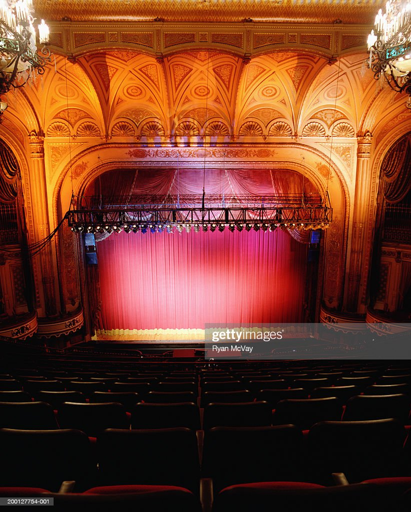 Interior of theater with red curtain : Stock Photo