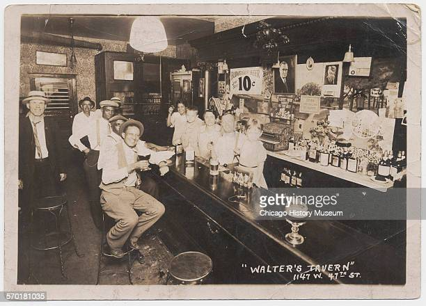 Interior of Walter's Tavern showing owners and familymembers behind the bar Chicago Illinois circa 1933 Pictured are from right to left Irene...