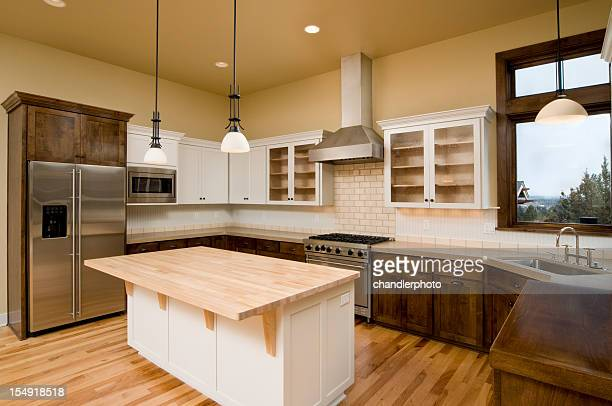 Interior photo of kitchen with wooden cabinets