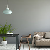 Square composition showing modern hipster interior with dark gray wall. This is a copy space template for designers and artists. Brown sofa with pillows, wooden armchair with table, large green plant