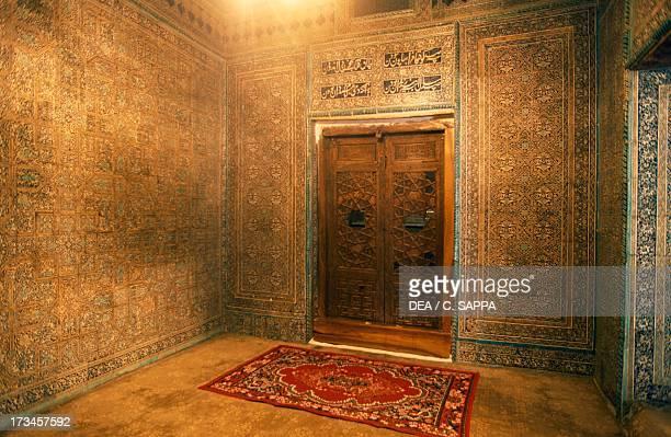 Interior room with carpet Mausoleum of Pahlavan Mahmud walled city of Khiva Uzbekistan