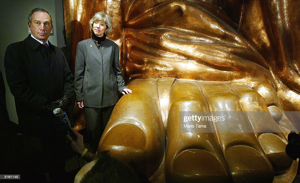 U.S. Interior Secretary Gale Norton and New York Mayor Michael Bloomberg (L) stand next to a full scale replica of the Statue of Liberty's foot during a press conference announcing the summer reopening of the landmark Statue March 30, 2004 in New York City. The statue has been closed since the September 11th terrorist attacks for renovation work and to improve safety and security systems.