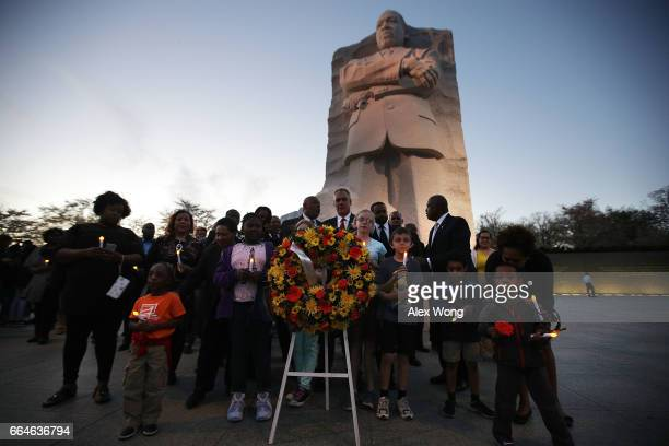 Interior Secretary Ryan Zinke and President and CEO of Friends of the Memorial Foundation Harry Johnson Sr participate in a wreath laying during a...