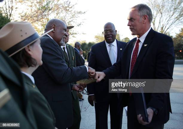 Interior Secretary Ryan Zinke fistbumps former National Park Service Director Robert Stanton as President and CEO of Friends of the Memorial...