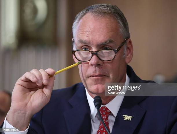 Interior Secretary Ryan Zinke listens to a question during a Senate Energy and Natural Resources Committee hearing on Capitol Hill on June 20 2017 in...