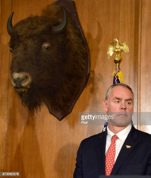 Interior Secretary Ryan Zinke listens to remarks by Vice President Mike Pence prior to President Donald Trump signing an 'Antiquities Executive...