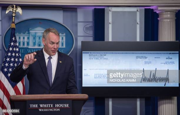 US Interior Secretary Ryan Zinke speaks as the first quarter check of US President Donald Trump's salary which he donated to the National Park...