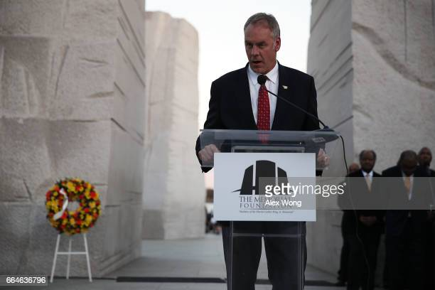 Interior Secretary Ryan Zinke speaks during a candlelight vigil at the Martin Luther King Jr Memorial April 4 2017 in Washington DC The Memorial...