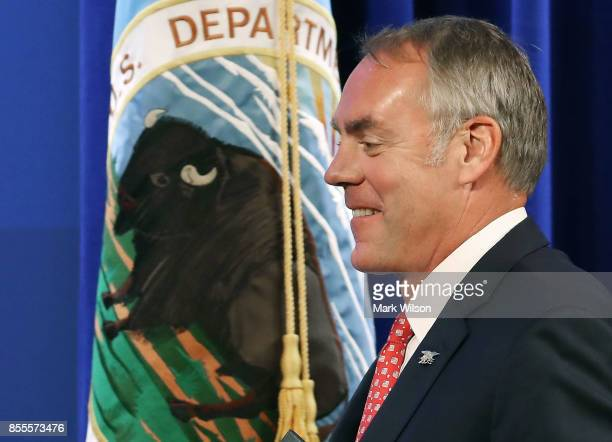 Interior Secretary Ryan Zinke walks up to deliver a speech billed as 'A Vision for American Energy Dominance' at the Heritage Foundation on September...