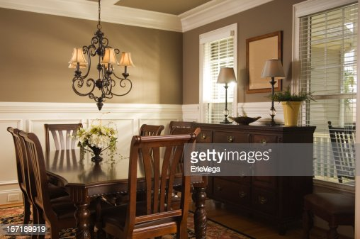 Interior view of a dining room with wooden furniture