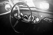 Interior view of classic vintage car. Instagram toning. Beautiful retro car poster, postcard.