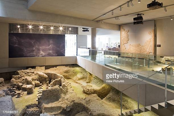 Interior view of exposed Roman remains and artifacts on 1st floor of museum The Novium Museum Europe United Kingdom Sussex Keith Williams Architects