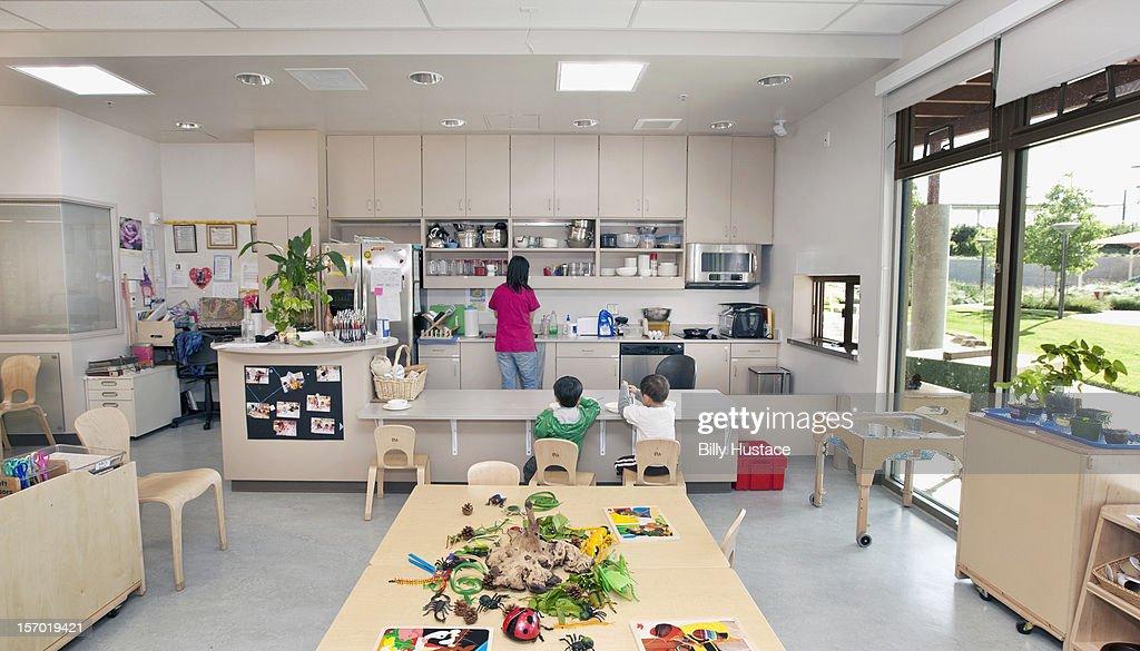 Interior view of preschool classroom and kitchen : Stock Photo
