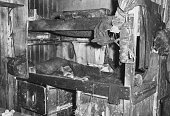 Interior view of the bunkroom in the hut of Captain Robert Falcon Scott at Cape Evans Ross Island Antarctica April 1961 Clothing hangs on the bunks...